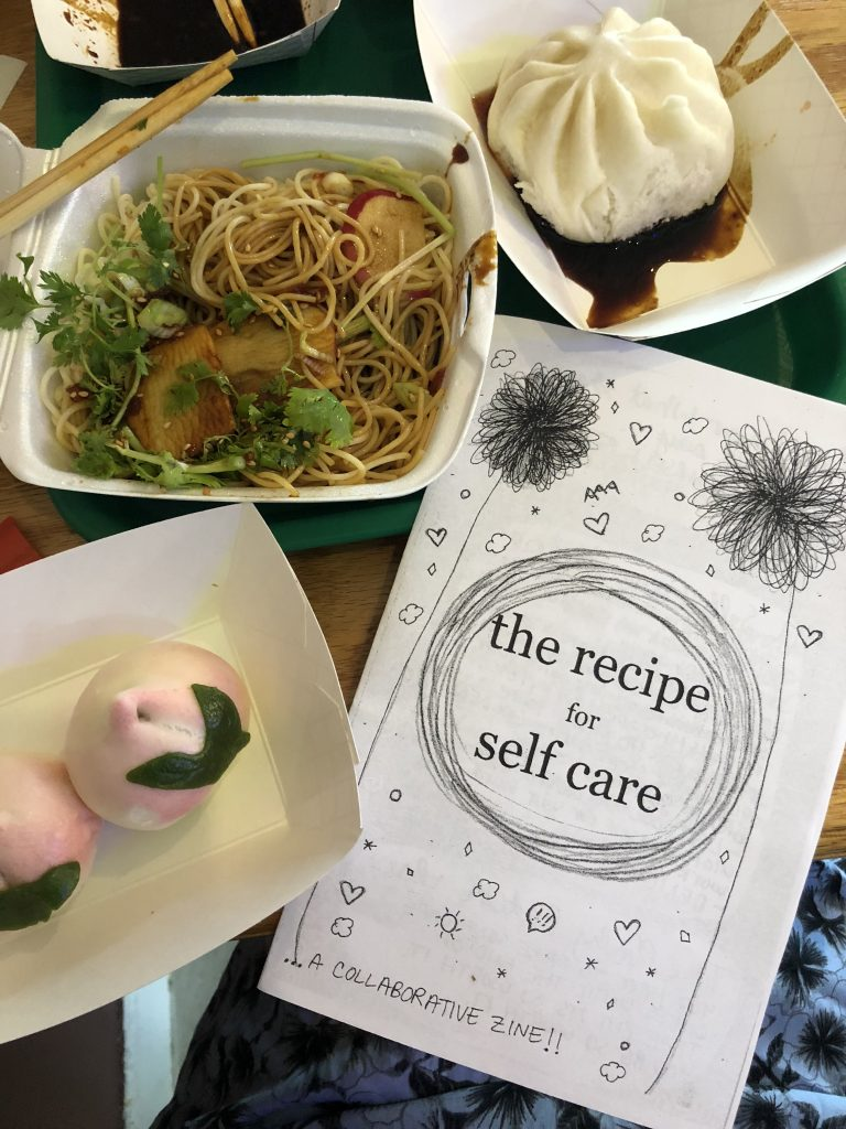 "a variety of food and a zine with the title ""the recipe for self care"""